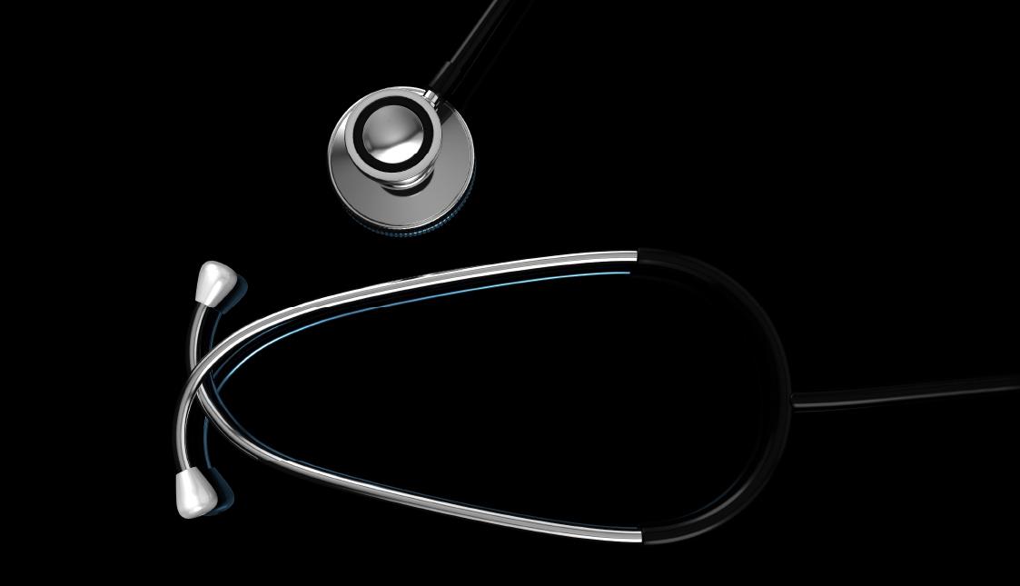 Stethoskop auf schwarzem Hintergrund