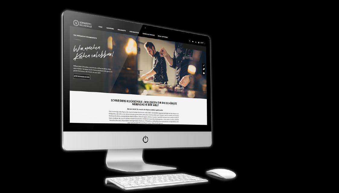 Ein Bildschirm vor schwarzem Hintergrund auf dem die neue Webseite von Schneiders Kochschule zu sehen ist