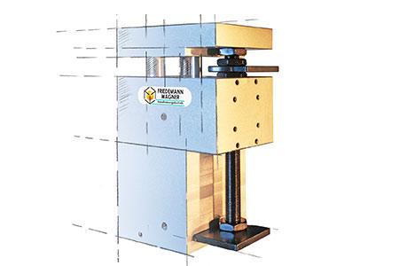 Logo und Maschinenkonstruktion von Friedemann Wagner GmbH